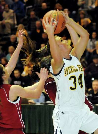 Averill Park's Bridget Carney (34), right, looks to the hoop during their Section II Class A basketb