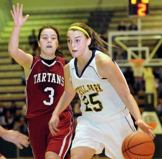 Averill Park's Brooke O'Shea (25), right, controls the ball as Scotia's Monica Compton defends durin