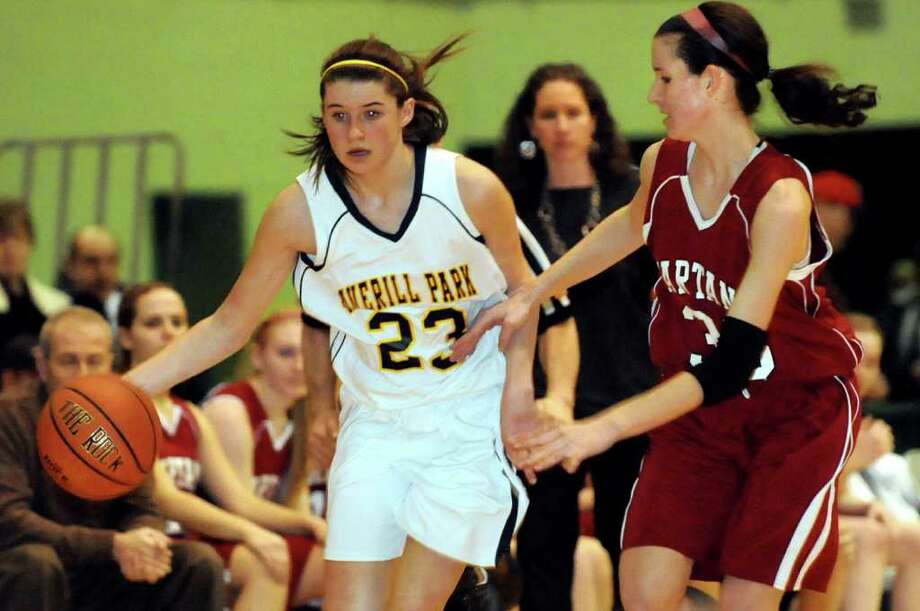 Averill Park's Alison Nunziato (23), left, controls the ball as Scotia's Sarah Janson (33) defends during their Section II Class A basketball game on Saturday, March 3, 2012, at Hudson Valley Community College in Troy, N.Y. (Cindy Schultz / Times Union) Photo: Cindy Schultz / 00016621A