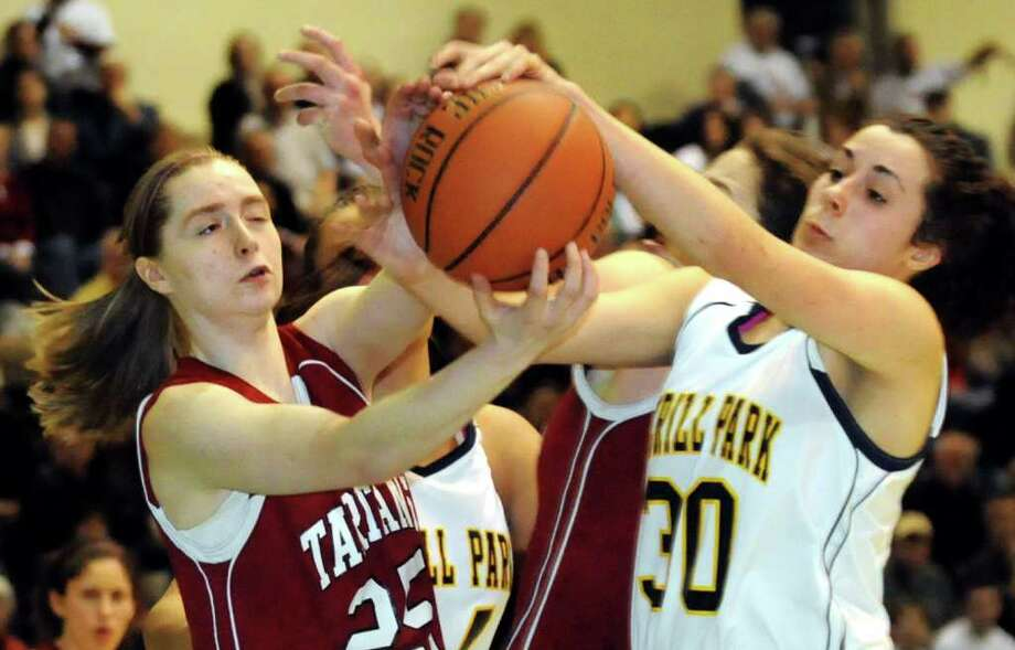 Scotia's Meqala MacDonald (25), left, battles Averill Park's Elaina Ryan (30) for a loose ball during their Section II Class A basketball game on Saturday, March 3, 2012, at Hudson Valley Community College in Troy, N.Y. (Cindy Schultz / Times Union) Photo: Cindy Schultz / 00016621A