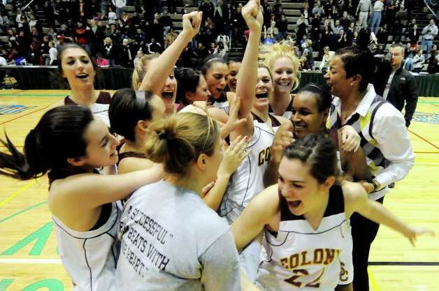 Colonie's team celebrates their victory over Albany in their Section II Class AA basketball game on Saturday, March 3, 2012, at Hudson Valley Community College in Troy, N.Y. (Cindy Schultz / Times Union) Photo: Cindy Schultz / 00016620A