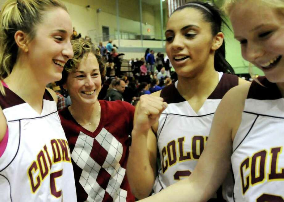 Colonie coach Heather Fiore, center, enjoys the win over Albany in their Section II Class AA basketball game on Saturday, March 3, 2012, at Hudson Valley Community College in Troy, N.Y. Joining Fiore are, from left, Ashley Loggins, Sydnie Rosales and Lexi Nolan. (Cindy Schultz / Times Union) Photo: Cindy Schultz / 00016620A