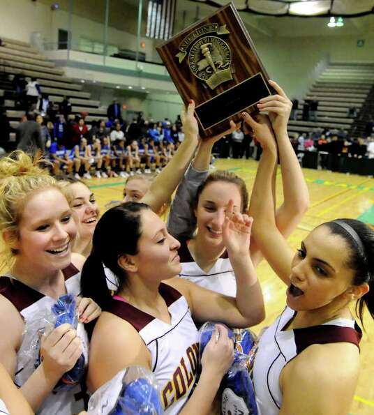 Colonie celebrates their win over Albany in theSection II Class AA basketball game on Saturday, Marc