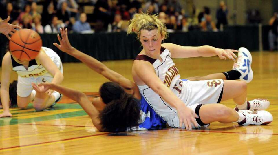 Colonie's Jaclyn Welch (10), right, gets tangled up with Albany's  Mylah Chandler (34) over a loose