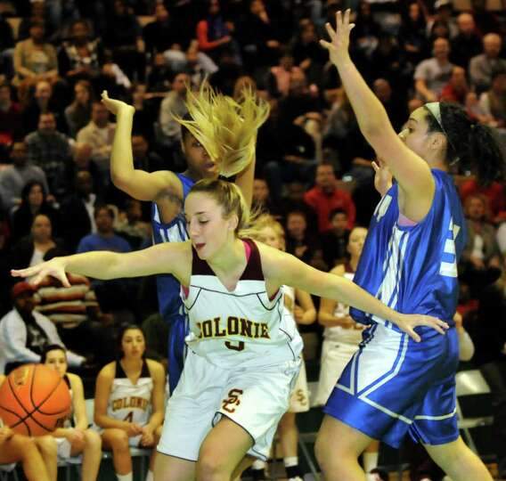 Colonie's Ashley Loggins (5), left, goes after a loose ball in their Section II Class AA basketball