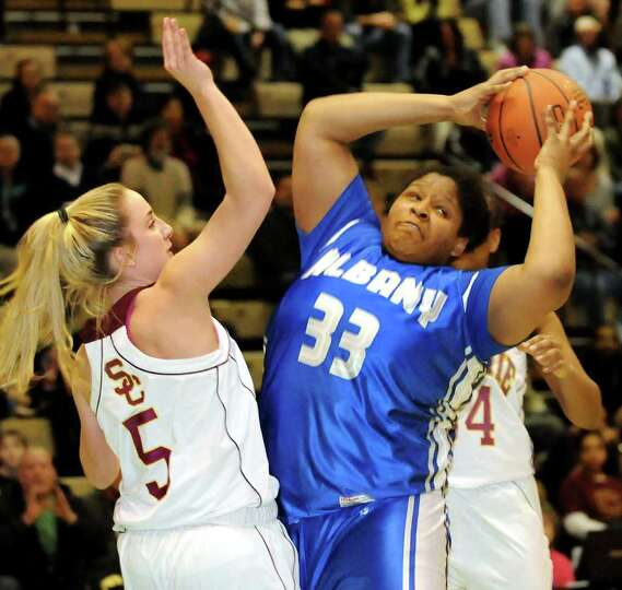 Albany's Melissa Canty (33), left, grabs the rebound as Colonie's Ashley Loggins (5) defends in thei