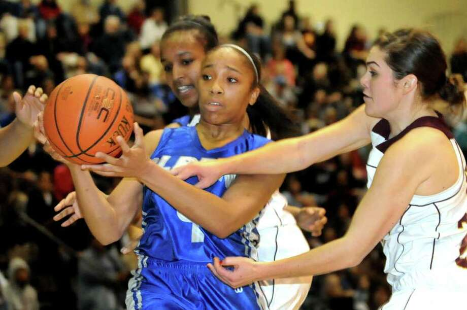 Albany's Emia Willingham-Hurst (4), left, grabs the rebound as Colonie's Laura Kipper (22) defends in their Section II Class AA basketball game on Saturday, March 3, 2012, at Hudson Valley Community College in Troy, N.Y. (Cindy Schultz / Times Union) Photo: Cindy Schultz / 00016620A