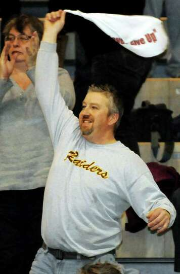Colonie High fan Jim Reittinger, whose daughter Kate plays on the team, cheers during their Section