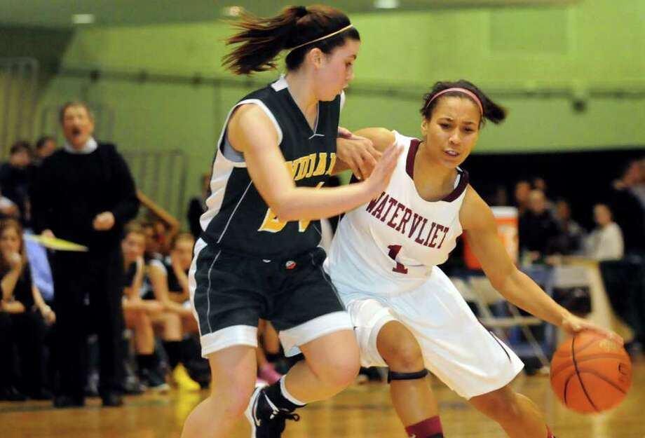 Watervliet's Ailayia Demand (1), right, controls the ball as Ravena's Samantha Randio (24) defends during their Section II Class B basketball game on Saturday, March 3, 2012, at Hudson Valley Community College in Troy, N.Y. (Cindy Schultz / Times Union) Photo: Cindy Schultz / 00016623A