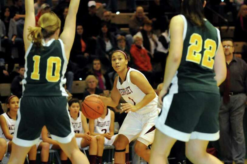 Watervliet's Ailayia Demand (1), center, controls the ball as Ravena's Jenica Stott (10), left, and
