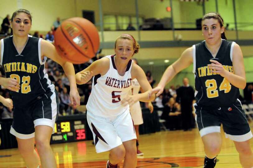 Watervliet's Alyssa Chartrand (5), center, and Ravena's Kayla Hotaling (22), left, and Samantha Rand
