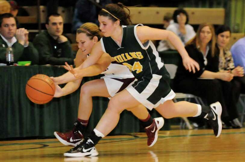 Watervliet's Katlyn Murray (11), left, and Ravena's Samantha Randio (24) chase a loose ball during t