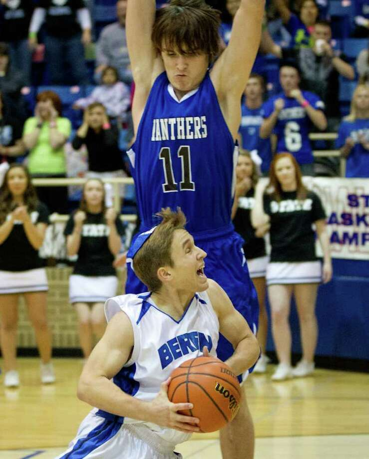 Beren Academy guard Isaac Mirwis (13) tries to drive to the basket as Abilene Christian forward Clint Bruton (11) defends. Photo: Smiley N. Pool, Houston Chronicle / © 2012  Houston Chronicle