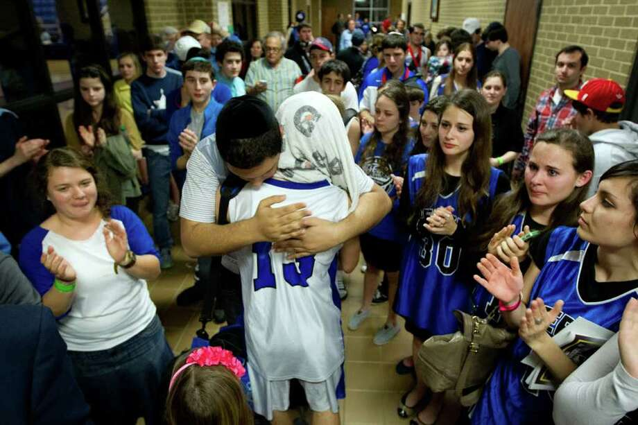 Isaac Mirwis is consoled by a crowd of supporters following the TAPPS state championship game. Photo: Smiley N. Pool, Houston Chronicle / © 2012  Houston Chronicle