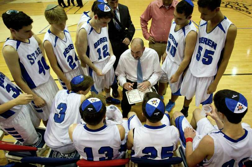 Beren Academy  players huddle during a time out with head coach Chris Cole.