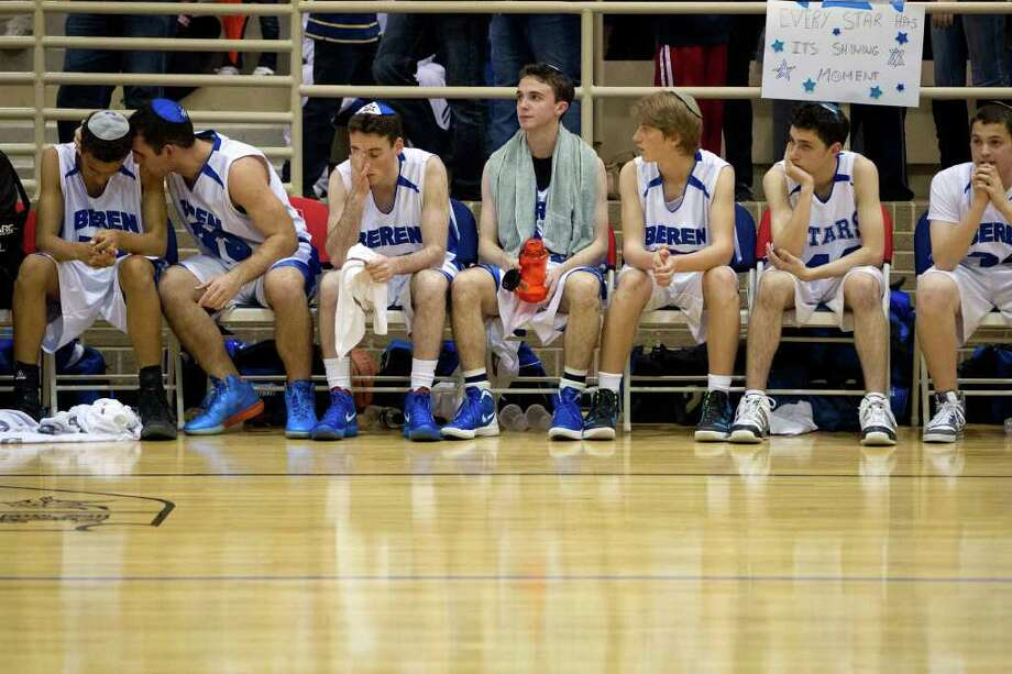 Beren Academy players sit on the bench during the fourth quarter. Photo: Smiley N. Pool, Houston Chronicle / © 2012  Houston Chronicle