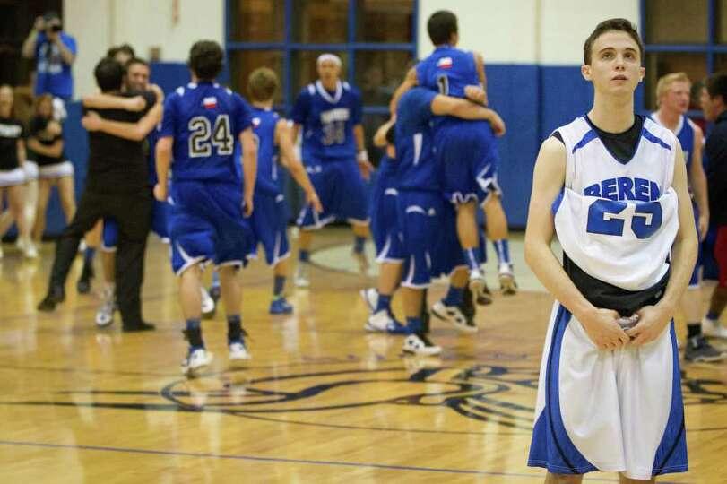 Beren Academy guard Isaac Buchine (25) looks away as Abilene Christian players celebrate their 46-42