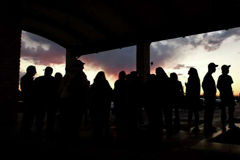 As darkness falls, a line of fans wait to enter the arena for the  the TAPPS 2A state championship b