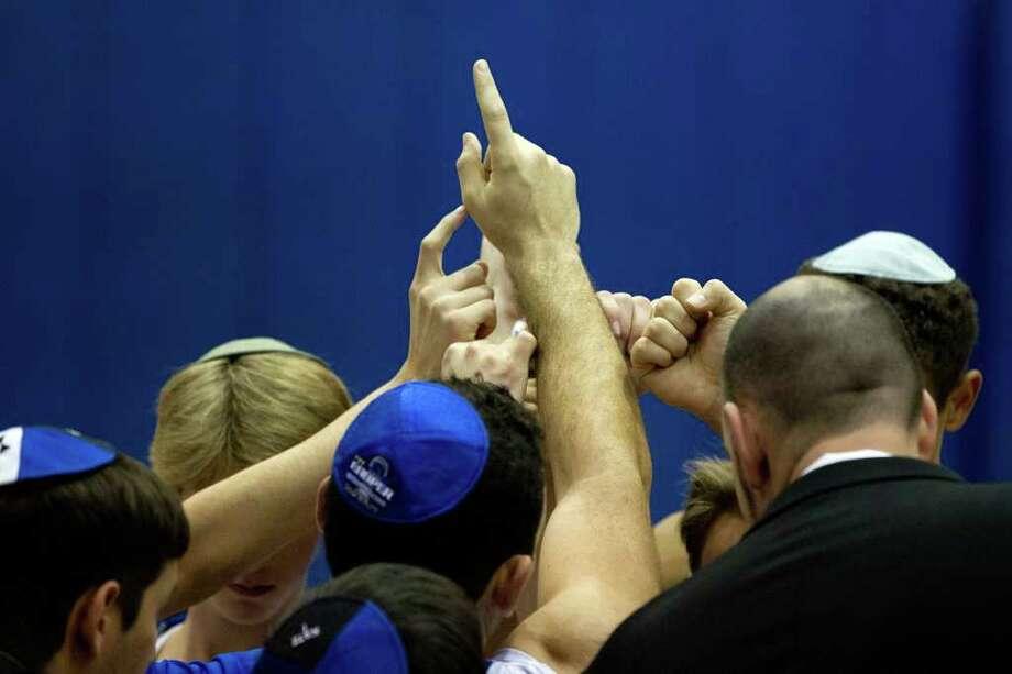 Beren Academy players huddle before facing Abilene Christian, Photo: Smiley N. Pool, Houston Chronicle / © 2012  Houston Chronicle