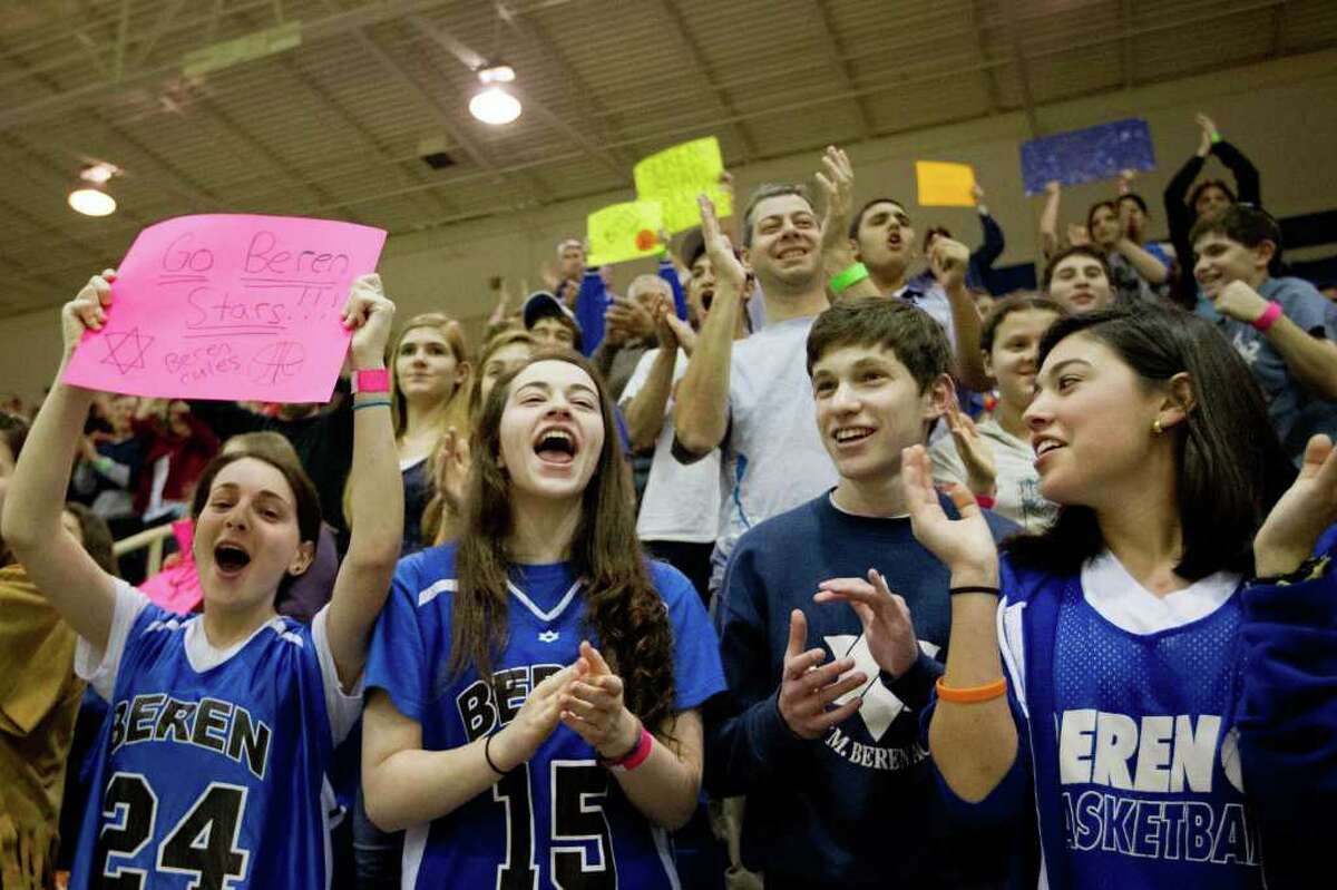 Beren Academy fans cheer as their team take the court to face Abilene Christian.