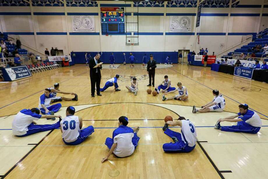 With less than 30 minutes to go before tip-off, the Beren Academy basketball team stretches before their TAPPS 2A state championship basketball game. Photo: Smiley N. Pool, Houston Chronicle / © 2012  Houston Chronicle