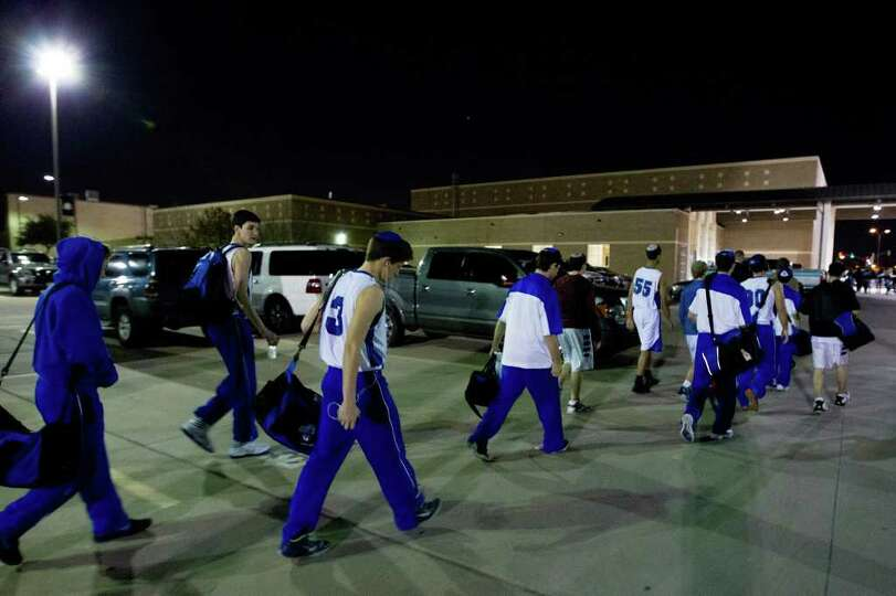 The Beren Academy basketball team arrives at the arena after darkness, about 30 minutes before the s