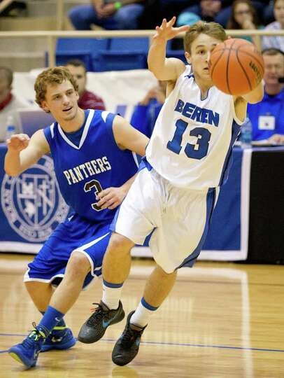 Beren Academy guard Isaac Mirwis reaches for the ball as he is defended by Abilene Christian guard B