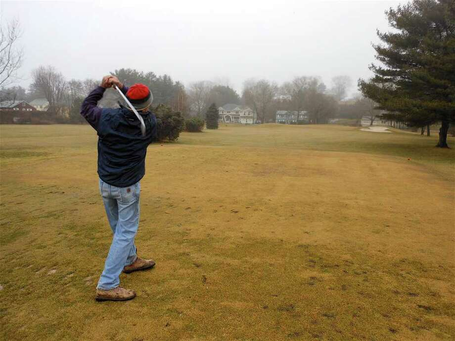 Doug Politi, who has played the Carl Dickman Par 3 Golf Course the past seven years, hit a few balls off the first tee despite the Saturday morning rain. Photo: Mike Lauterborn / Fairfield Citizen contributed