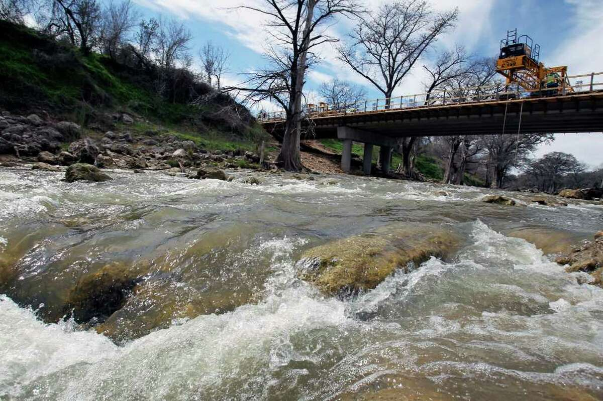 Recent rainfall helps water gush through the Guadalupe River in the Rebecca Creek Road area upstream from Canyon Lake in late February. Last year, the river ran dry in areas such as this.