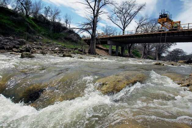 Recent rainfall helps water gush through the Guadalupe River in the Rebecca Creek Road area upstream from Canyon Lake in late February. Last year, the river ran dry in areas such as this. Photo: TOM REEL, San Antonio Express-News / San Antonio Express-News