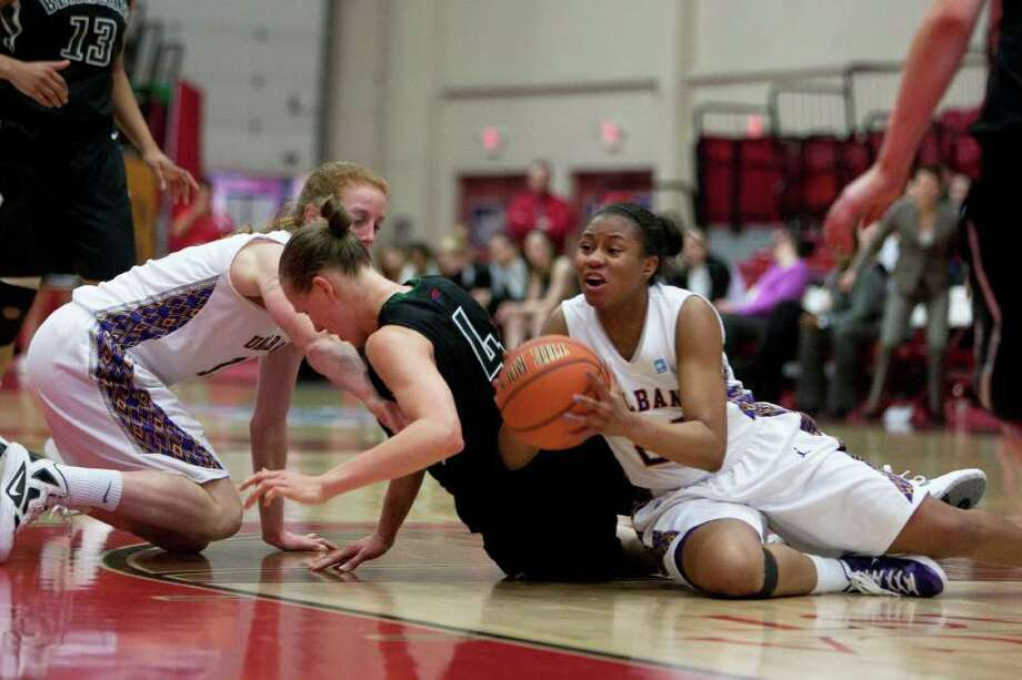 Adrienne Jones (right) of UAlbany gathers a loose ball on the floor, during an America East Semifinal game where the Great Danes defeated Binghamton 58-50 at Chase Family Arena in Hartford, CT on March 4, 2012 (Shane Bufano/Special to the Times Union). Photo: Shane Bufano
