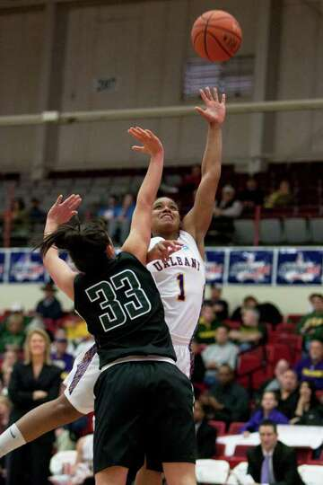 Cassandra Callaway of UAlbany attempts a lay up as she is defended by Mallory Lawes of Binghamton, d
