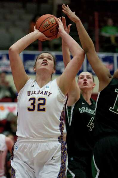 Megan Craig of UAlbany attempts a layup, during an America East Semifinal game where the Great Danes