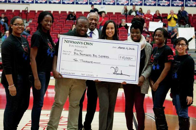 Big Brothers Big Sisters of Albany accepts a $10,000 check from Newman's Own Foundation at halftime
