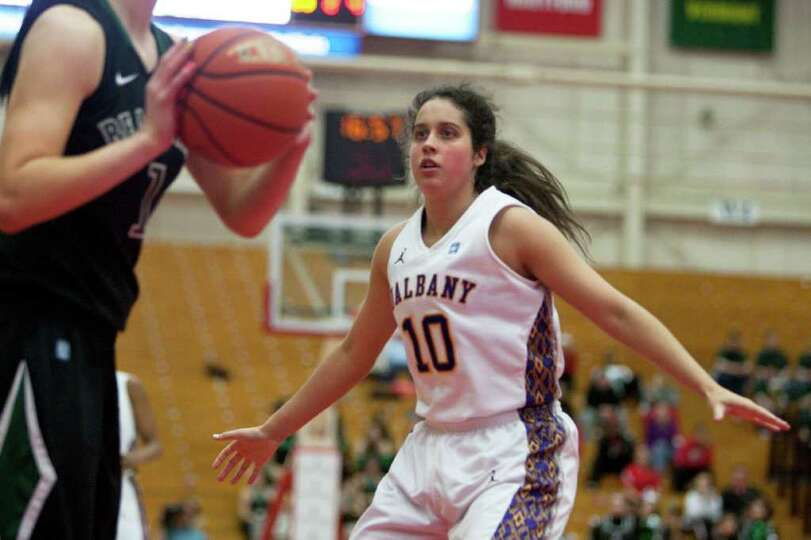 Lindsay Lowrie (right) of UAlbany presses Orla O'Reilly of Binghamton, during an America East Semifi