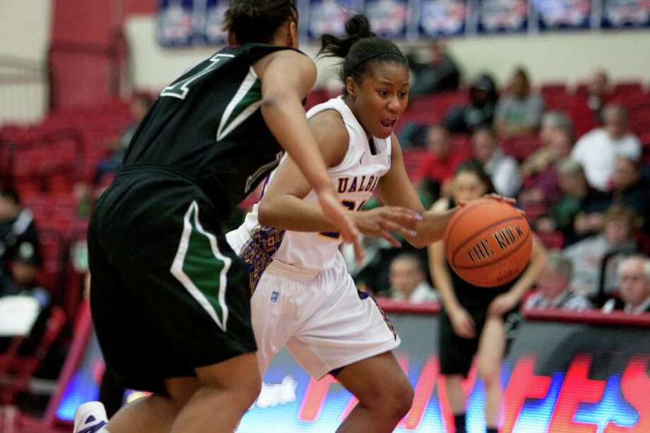 Adrienne Jones (right) of UAlbany steals the ball on the press from Andrea Holmes of Binghamton, during an America East Semifinal game where the Great Danes defeated Binghamton 58-50 at Chase Family Arena in Hartford, CT on March 4, 2012 (Shane Bufano/Special to the Times Union). Photo: Shane Bufano