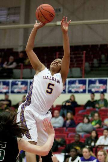 Ebone Henry of UAlbany is fouled on a shot attempt, during an America East Semifinal game where the