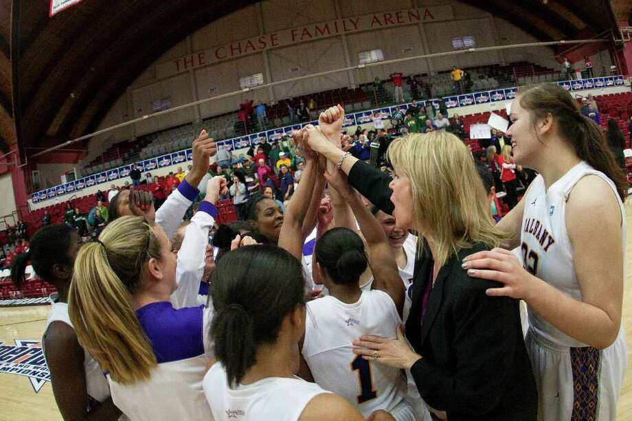 The UAlbany Women's Basketball team celebrates after defeating Binghamton University 58-50 in an America East Semifinal game at Chase Family Arena in Hartford, CT on March 4, 2012. Photo: Shane Bufano