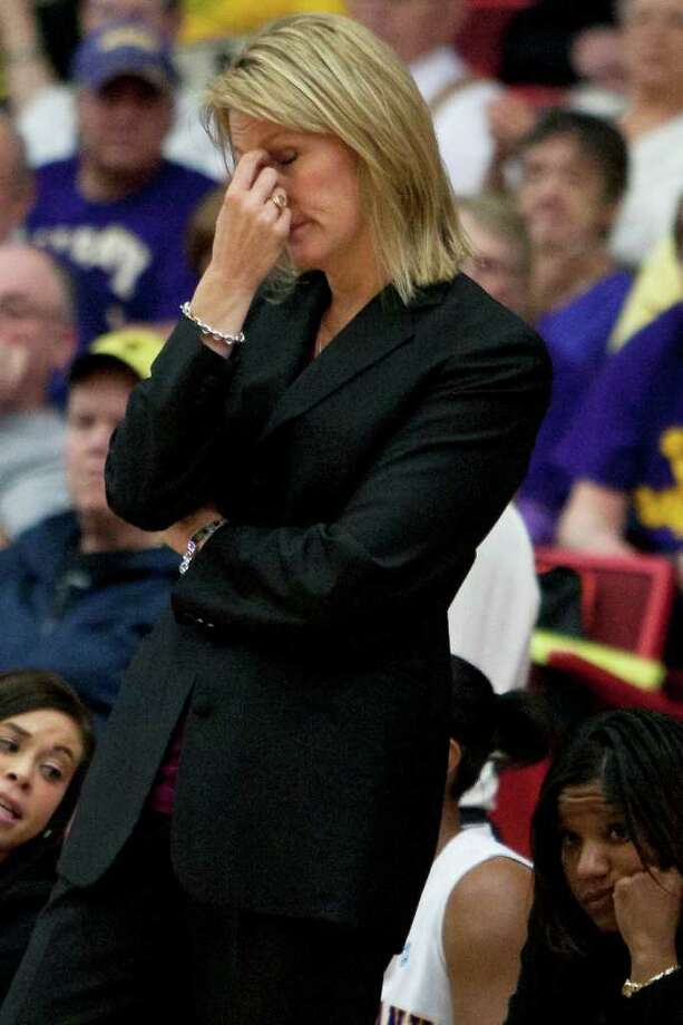 UAlbany Womens Basketball coach Katie Abrahamson-Henderson shows emotion as Binghamton makes a run at the  America East Semifinal game.   The Great Danes prevailed, however as theydefeated Binghamton 58-50 at Chase Family Arena in Hartford, CT on March 4, 2012 (Shane Bufano/Special to the Times Union). Photo: Shane Bufano