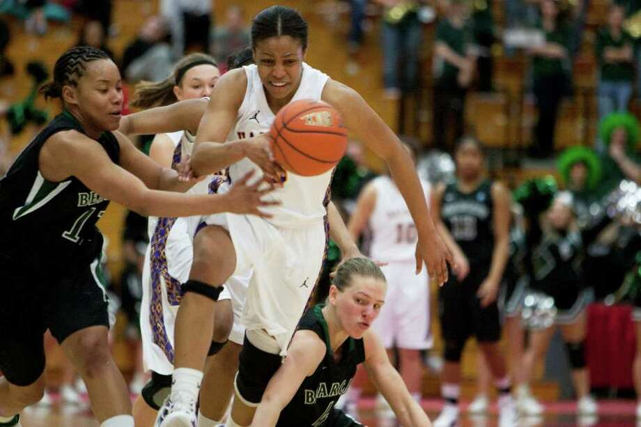 Ebone Henry (center) of UAlbany steals the ball from Andrea Holmes (left) of Binghamton, during an America East Semifinal game where the Great Danes defeated Binghamton 58-50 at Chase Family Arena in Hartford, CT on March 4, 2012 (Shane Bufano/Special to the Times Union). Photo: Shane Bufano