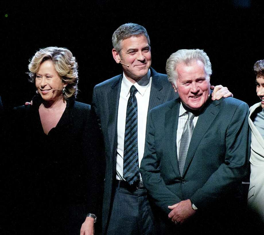 "From left to right, actress Yeardley Smith, actor George Clooney, and actor Martin Sheen take a bow during the curtain call at the Los Angeles premiere of the play ""8"" in Los Angeles on Saturday, March 3, 2012. (AP Photo/Dan Steinberg) Photo: DAN STEINBERG"
