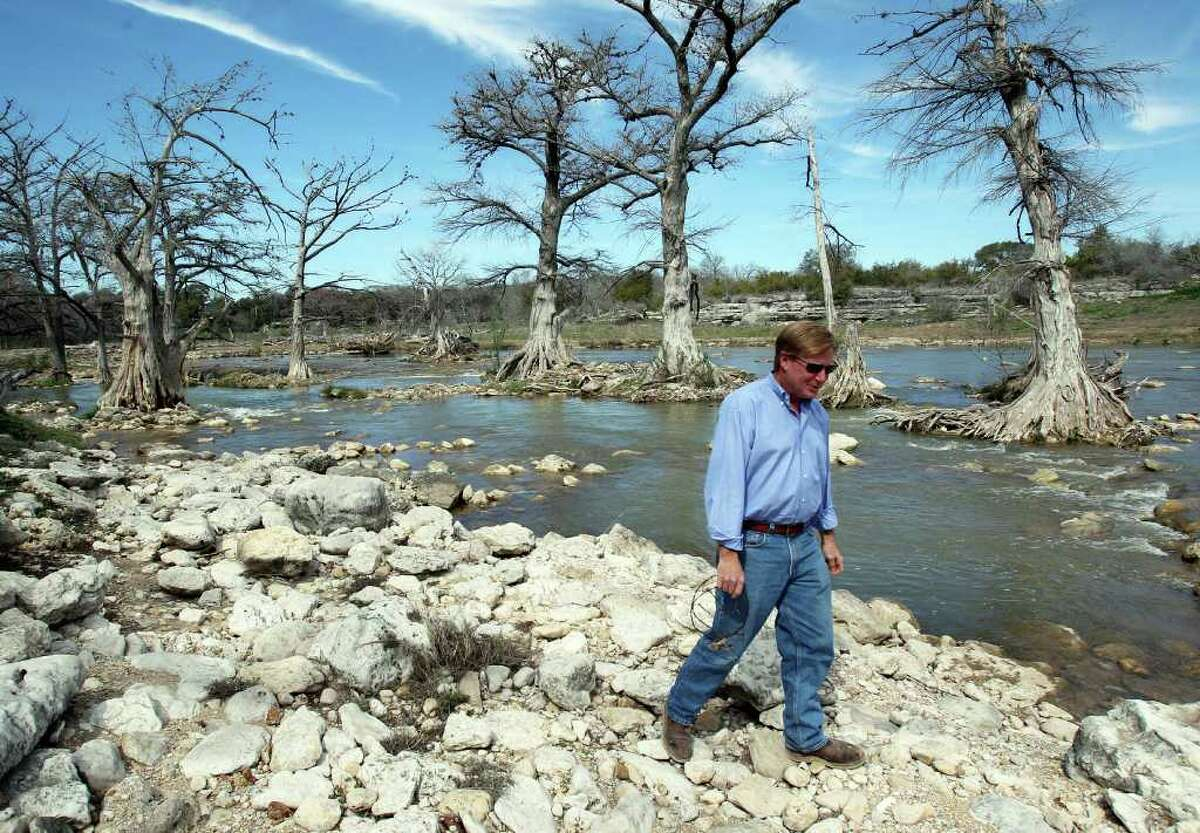 Flowing, for now: Bret Barnett, who owns property along the Guadalupe River, walks in late February in an area upstream from Canyon Lake where the river stopped flowing last year.