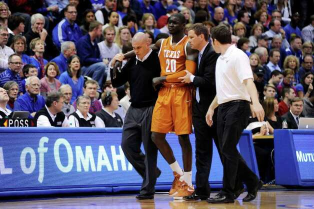 Texas' Alexis Wangmene (20) is helped off the court after being injured in the second half of an NCAA college basketball game against Kansas, Saturday, March 3, 2012, in Lawrence, Kan. Kansas won 73-63. Photo: AP