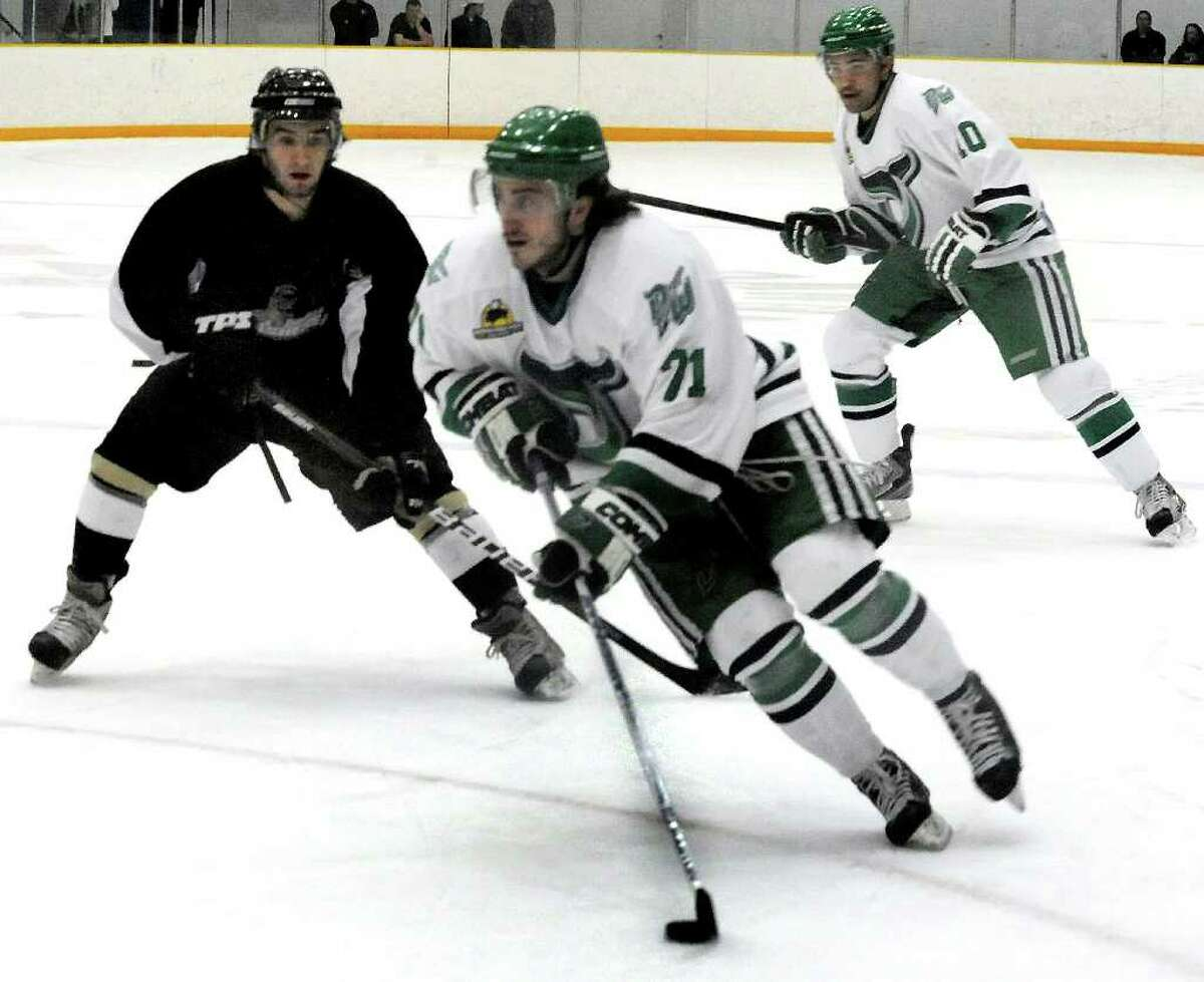 Danbury's #71 Carlo Ricci moves the puck against The Danville Dashers on Saturday, March 4, 2012.