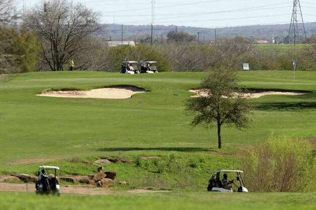 Golfers play the course at the Mission Del Lago Golf Course, Sunday, March 4, 2012. San Antonio Police were at the course investigating a shooting of a male golfer on the No. 12 green He was hit around the left shoulder area and taken to a local hospital with a non-life threatening injury. Officers on the scene speculated that a stray bullet hit the golfer. Photo: JERRY LARA, San Antonio Express-News / SAN ANTONIO EXPRESS-NEWS