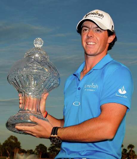 Rory McIlroy holds the trophy after winning the Honda Classic golf tournament in Palm Beach Gardens, Fla., Sunday, March 4, 2012. McIlroy became the top-ranked golfer in the world. (AP Photo/Rainier Ehrhardt) Photo: Rainier Ehrhardt / FR155191 AP