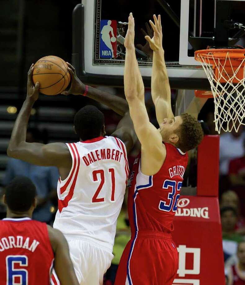 Samuel Dalembert (21) of the Houston Rockets tries for a shot against Kenyon Martin (2) of the Los Angeles Clippers in the first half on Sunday, March 4, 2012, in Houston, Texas. (George Bridges/MCT) Photo: George Bridges, McClatchy-Tribune News Service / MCT