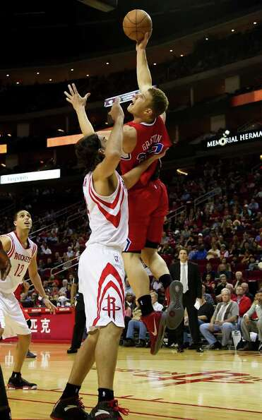 Blake Griffin (32) of the Los Angeles Clippers takes a shot over Luis Scola (4) of the Houston Rocke