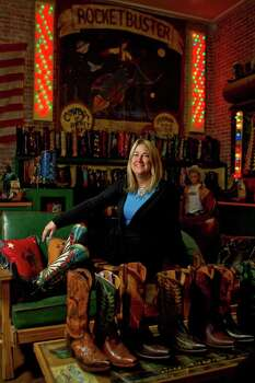 Nevena Christi of Rocketbuster Boots sits in her showroom Wednesday, Feb. 9, 2011, in El Paso. Rocketbuster is located in an old fur trader's business building. Photo: Nick De La Torre, Houston Chronicle / Houston Chronicle
