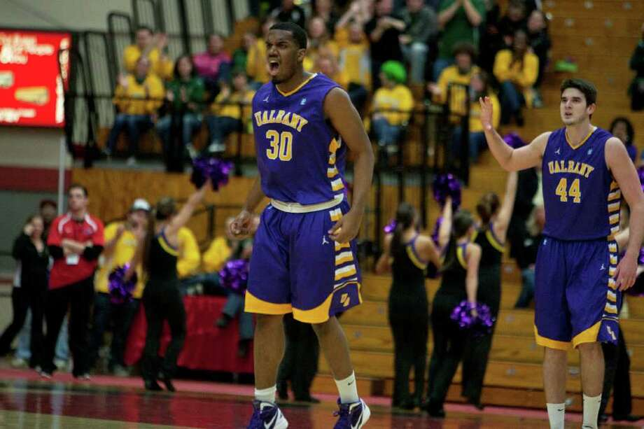 Jayson Guerrier of UAlbany (Center) celebrates after he nails a three-point shot for the Great Danes, during the America East Mens semifinal against Stony Brook at Chase Family Arena in Hartford, CT on March 4, 2012 (Shane Bufano/Special to the Times Union). Photo: Shane Bufano